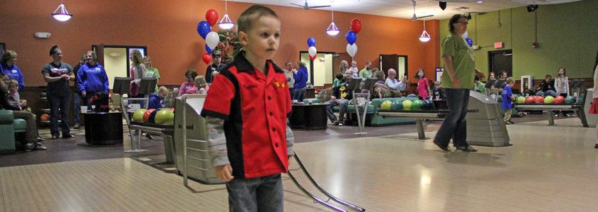 a little boy bowling